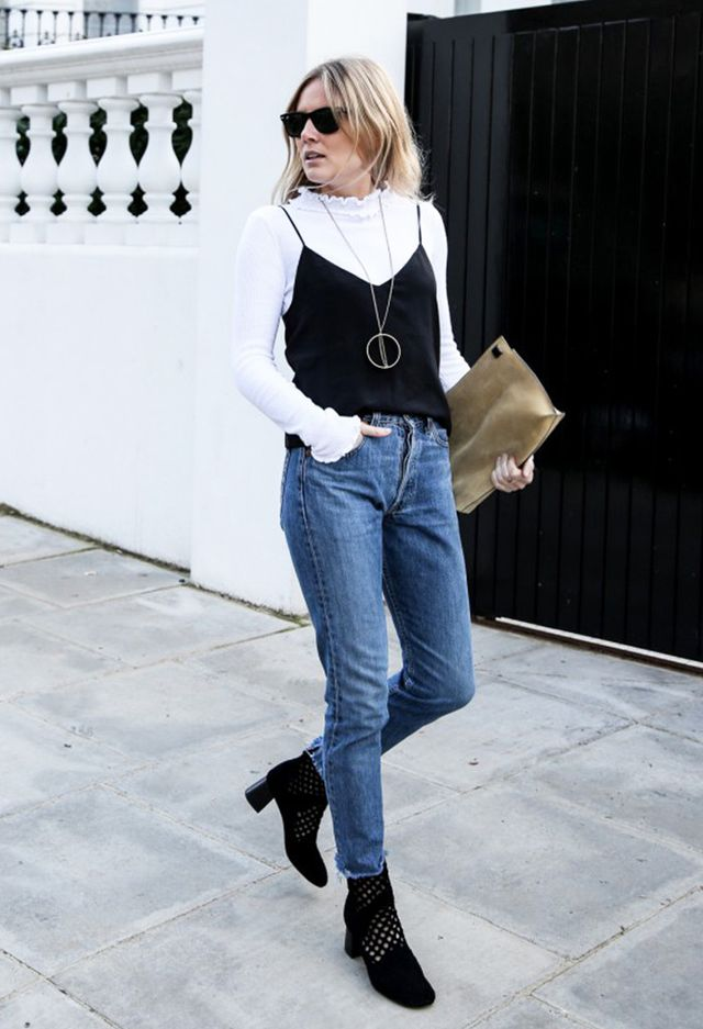 Lucy Williams of Fashion Me Now blog in 90s layering style with turtleneck, cami, and jeans