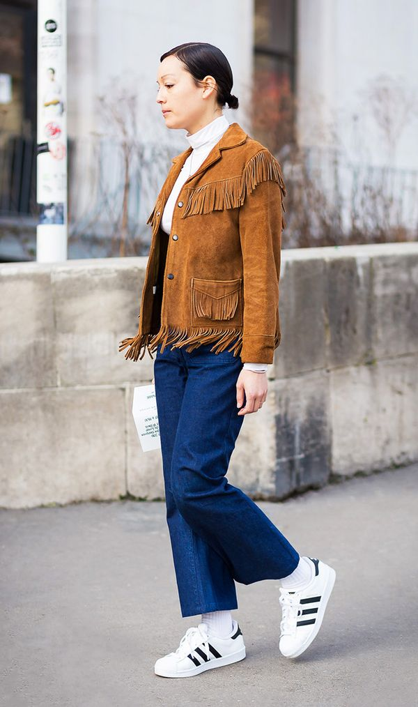 For a polished yet sleek look, go for tailored jeans, a turtleneck, white sneakers, and finish the ensemble off with a suede jacket.