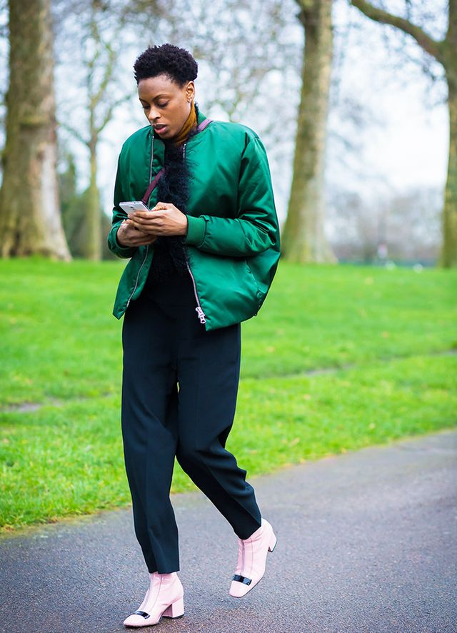 Donna Wallace wearing pink Dorateymur ankle boots and green puffy bomber jacket.
