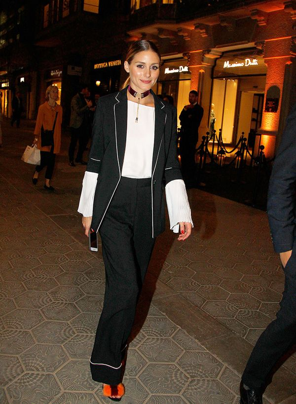 Here's that short-sleeve blazer look again—so pretty for a night out with a white top and fun heels. On Olivia Palermo: Massimo Dutti Pleated Sleeve Top ($53); Gianvito Rossi Zelda Sandals...