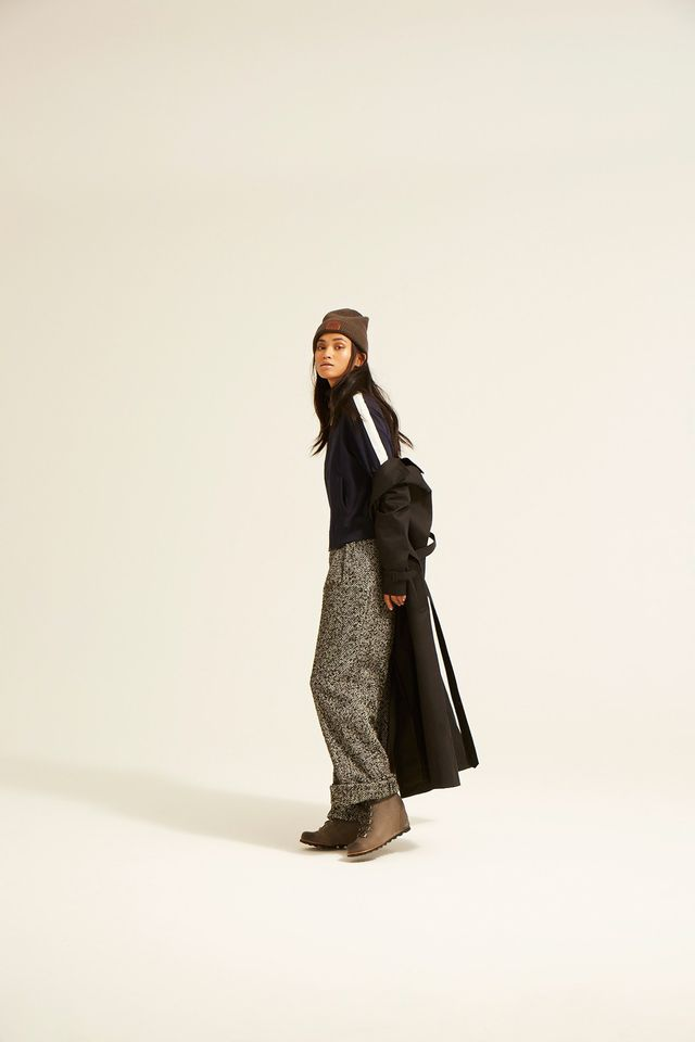 An unconventional pairing, yes, but the tailored silhouette of tweed trousers paired with lace-up wedge boots triggers an interesting play on proportions. The athletic zip-up jacket and the black...