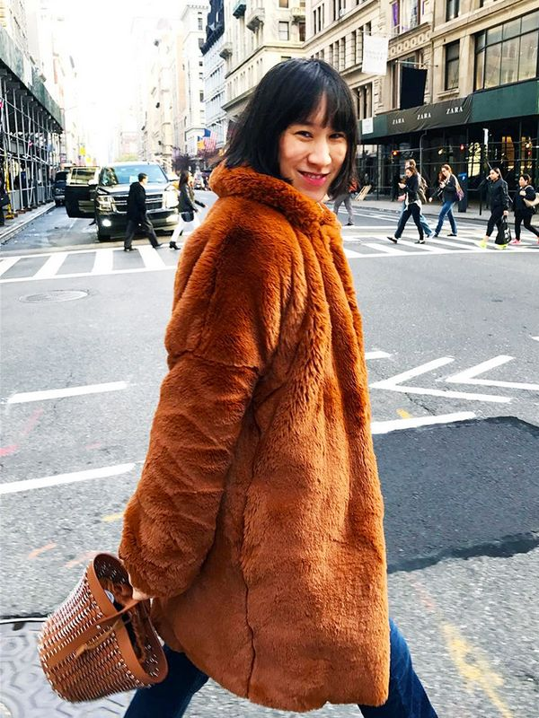 Eva Chen braves the chilly streets of New York City in a fluffy statement coat.