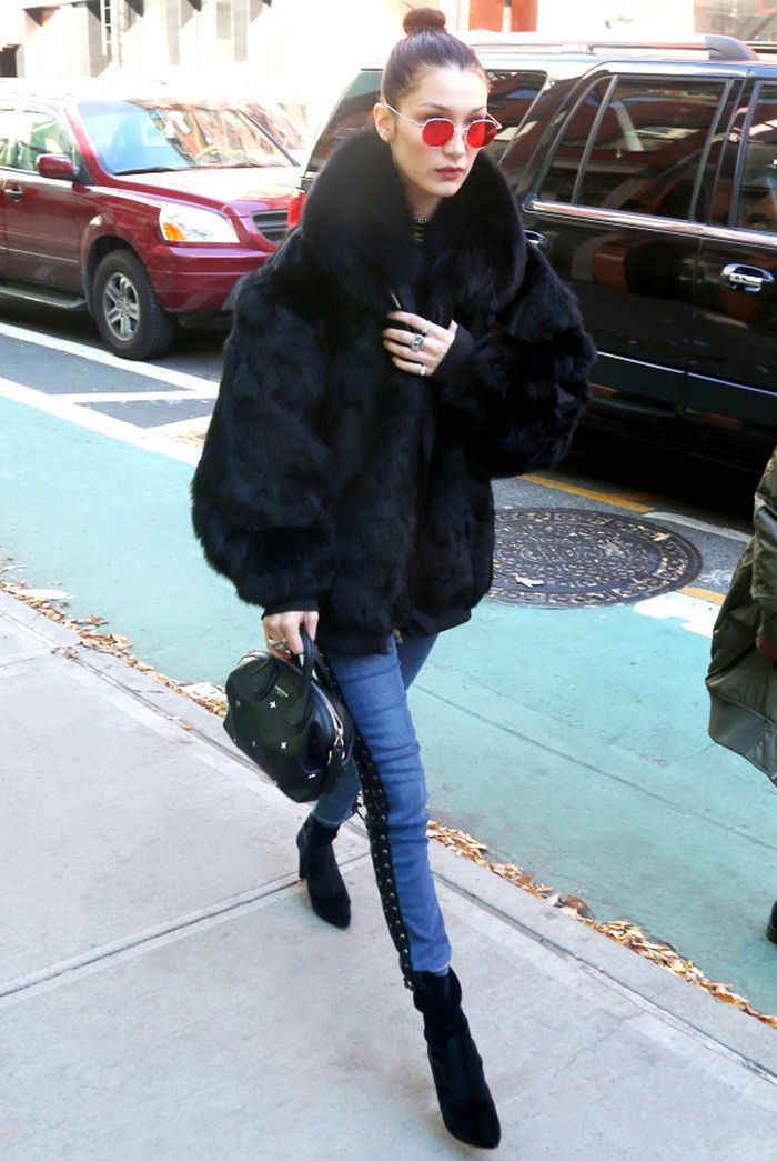 day-to-night outfit: Bella Hadid in a faux-fur coat