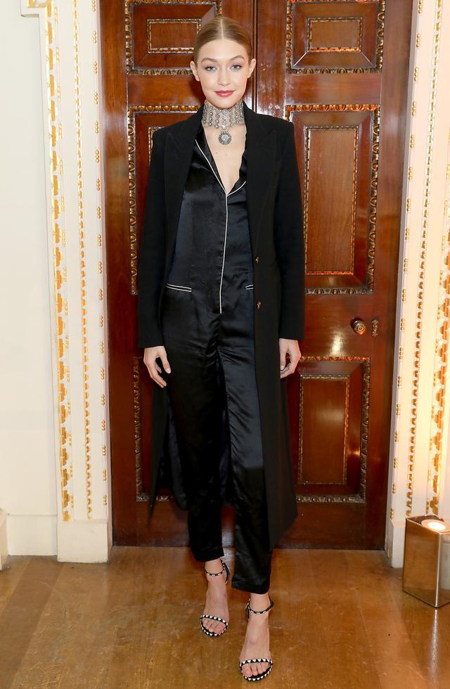 On Gigi Hadid: Smythe Brando Coat($995); Fleur du Mal Pajama Jumpsuit($595); Stuart Weitzman Pavé Nudist in Jet Chevron($2895).