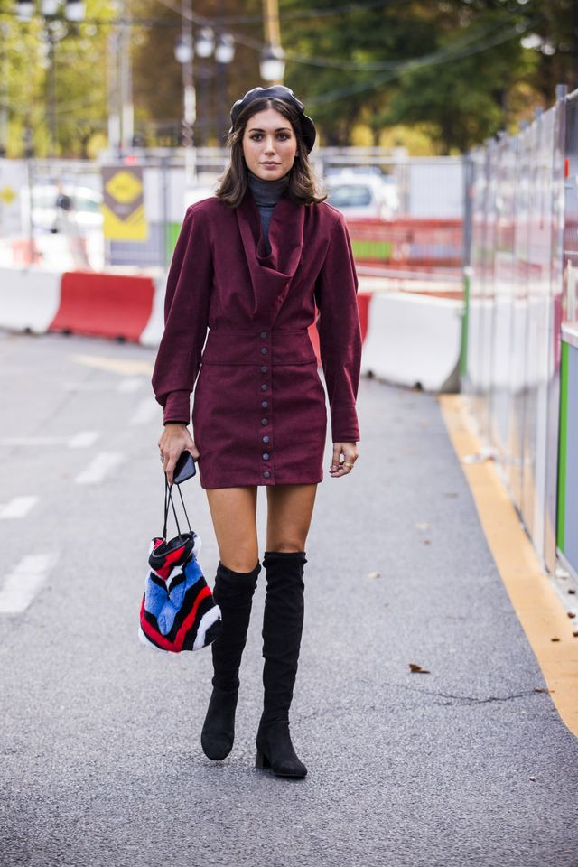 How to give a simple top and skirt combo an elevated feel? Add a beret and over-the-knee boots.