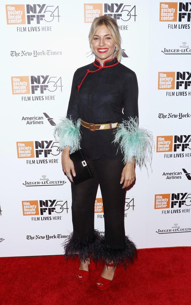 On Sienna Miller: Prada top, pants, and belt.