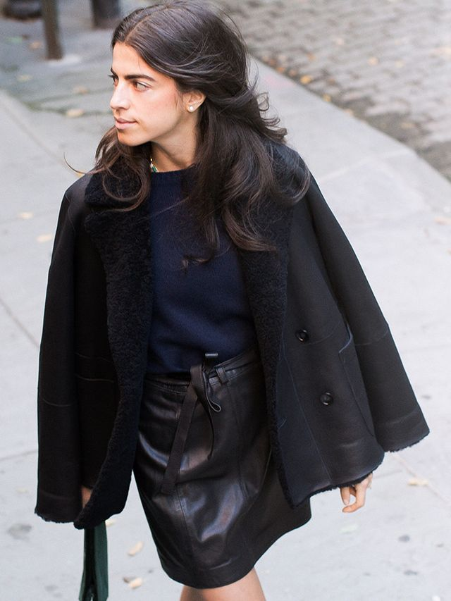 Balance out an edgy leather mini skirt with a crewneck sweater and draped shearling bomber.