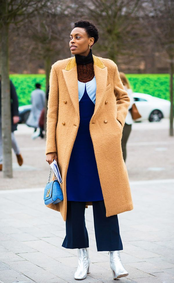 This layered look is so sleek with the turtleneck underneath a dress, which is layered over of-the-moment flares.