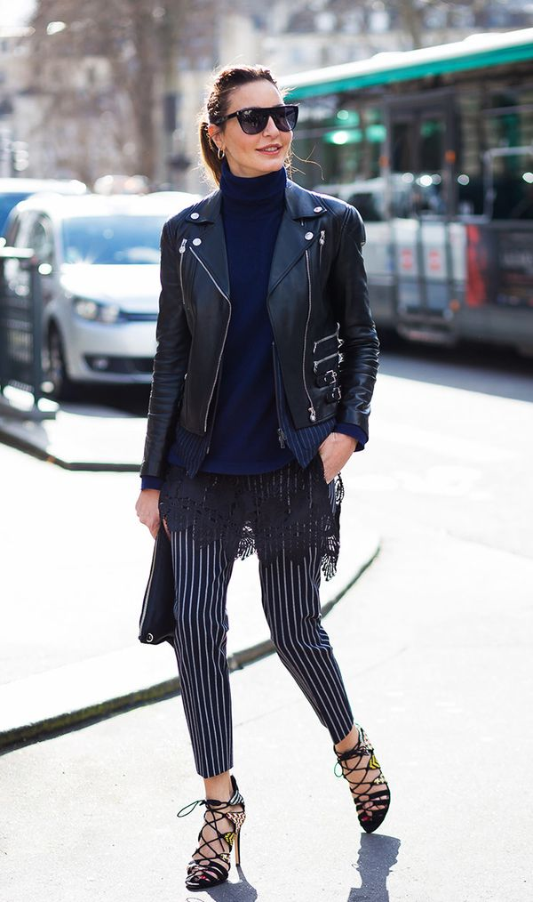 This is the cool-girl uniform—a turtleneck with a moto jacket and statement pants.