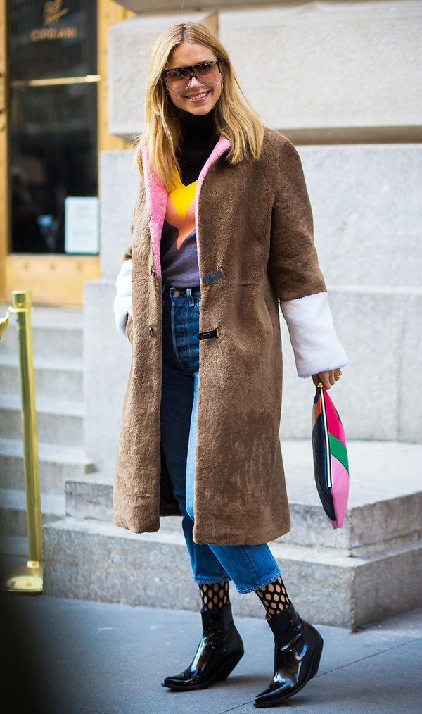 Want to stay warm and look chic? Try a patterned turtleneck under a furry coat with jeans.