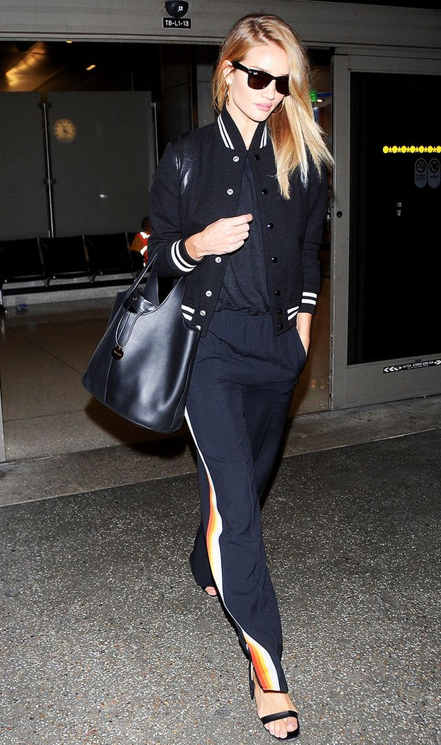 Rosie Huntington-Whiteley arrives on a flight at LAX Airport on September 21, 2016 in Los Angeles, California.
