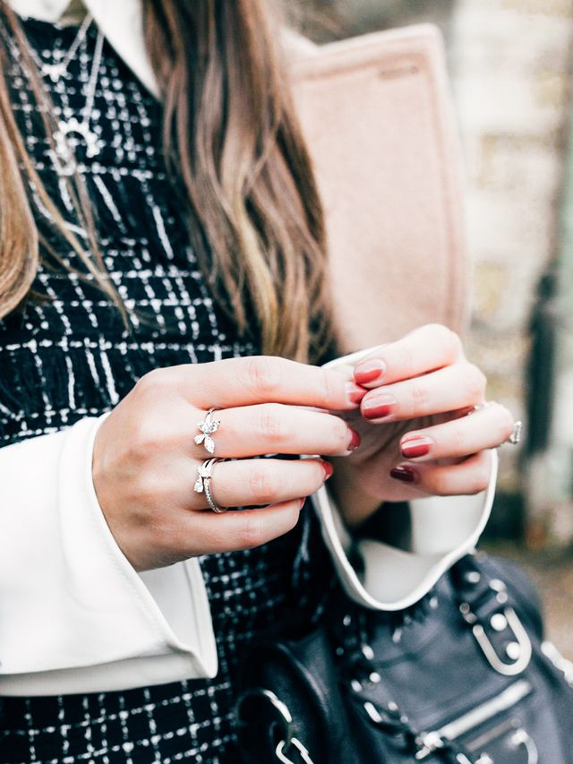 """In addition to necklaces, Cipoletti's date-night must-haves include a single ring that wraps around two fingers, like thisHearts on Fire Aerial Double Ring. (""""It's a beautiful way to catch..."""