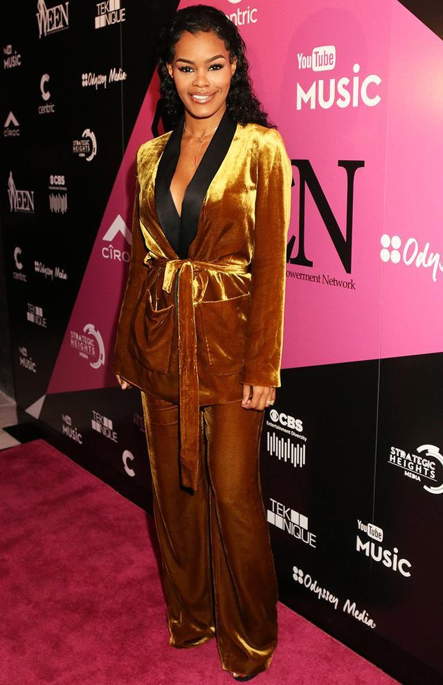 On Teyana Taylor: Zara Velvet Jacket With Belt(£90) andVelvet Trousers(£60).