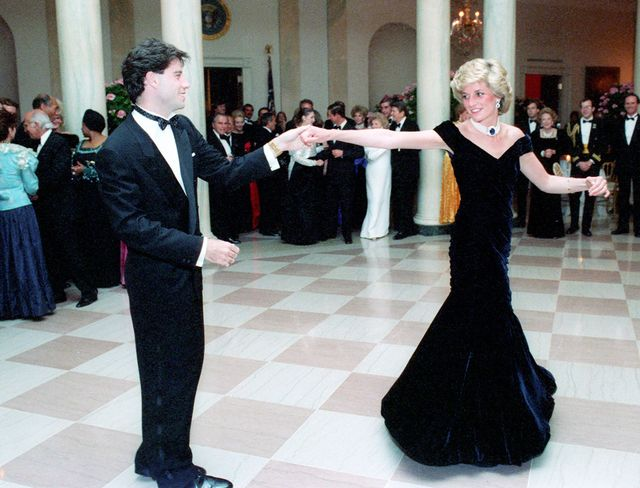 Diana wearing a stunning blue velvet dress to the White House dinner, and dancing with John Travolta. 
