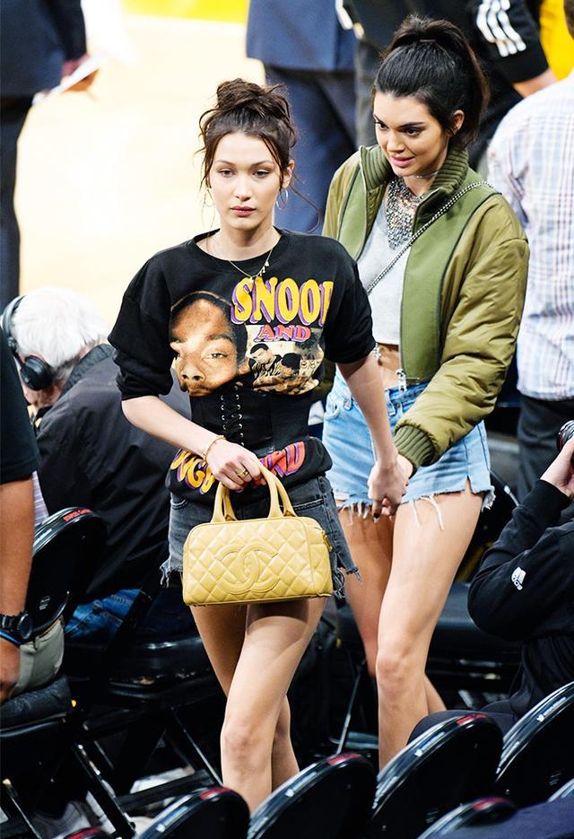 On Bella Hadid: Jennifer Fisher XL Smooth Circle Earrings ($215); Vintage Snoop Dogg Doggystyle Sweatshirt; So Monroe Bella Black Faux Leather Corset Belt($19); Bardot Erin Cutoff Shorts($26);...