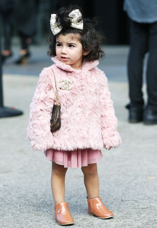 You can't go wrong with a furryjacket and pleated skirt. That hair bow doesn't hurt, either.