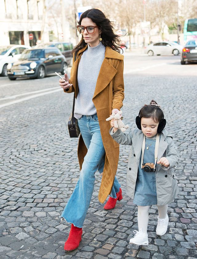 Layers, layers, layers! Put a coat on top of a dress, and add cozy accessories like earmuffs and tights.