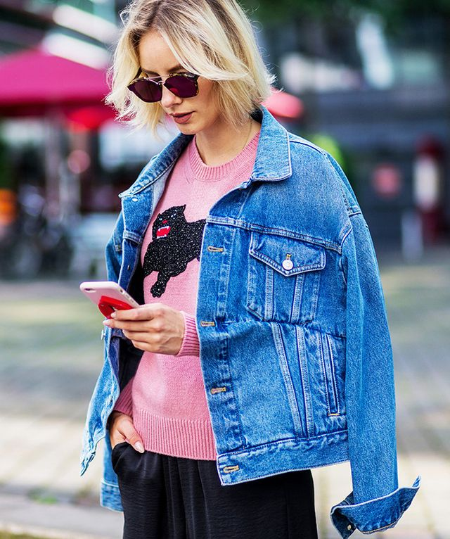 The easiest way to give your jean jacket some polish is by draping it over your shoulders.