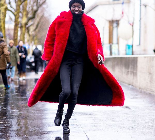 Style a black turtleneck and skinny jeans with a bright, bold coat.