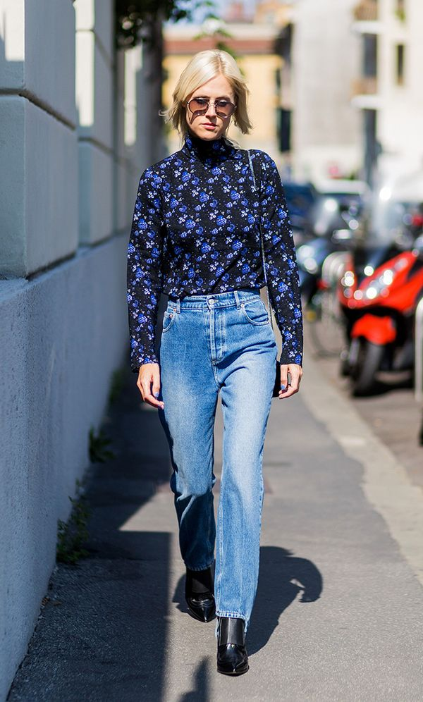 Find a turtleneck in a playful print, and style it with blue jeans and ankle boots.