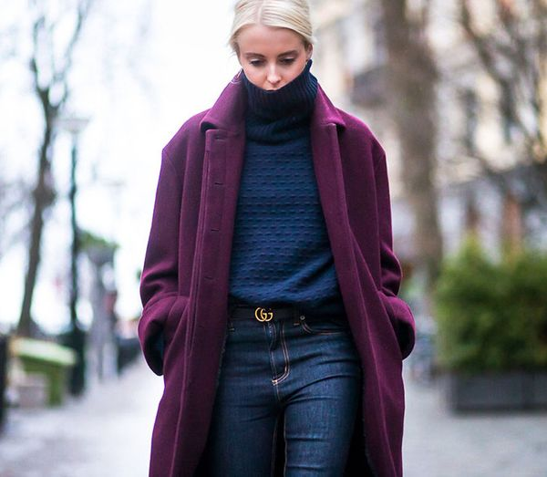 Find a coat that complements the color of your turtleneck. A gold hardware belt is a great finish, too.