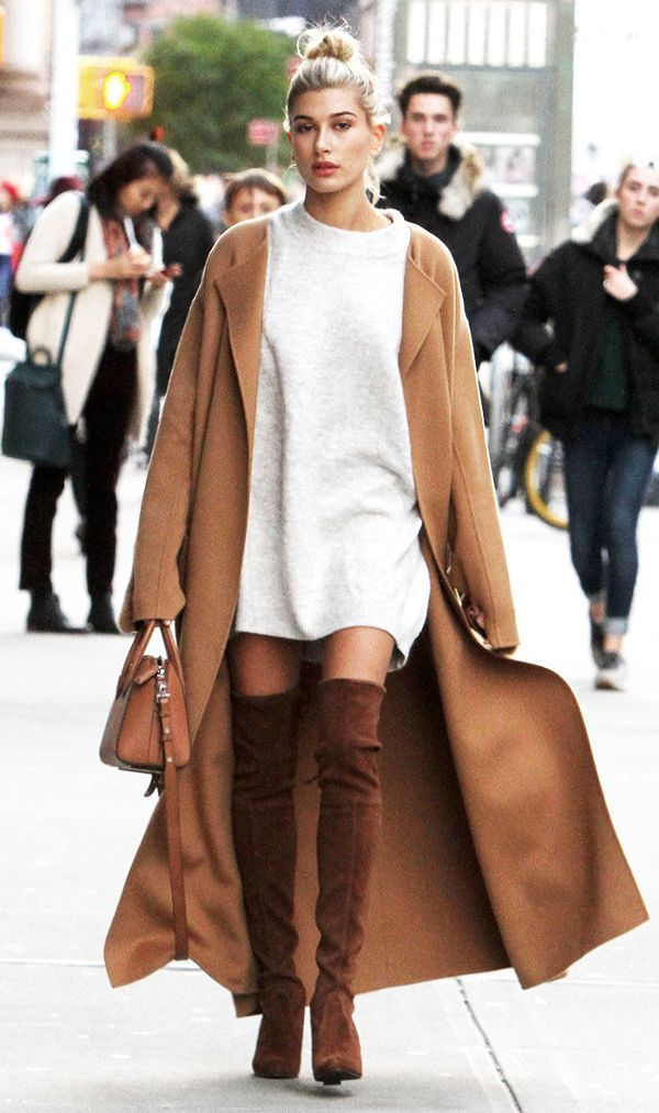 On Hailey Baldwin: Cyclas coat; Stuart Weitzman Suede Highland Boots ($798); Givenchy Antigona Small Bag ($2280) Floor-dusting coats are all the rage. Style your boots with a...