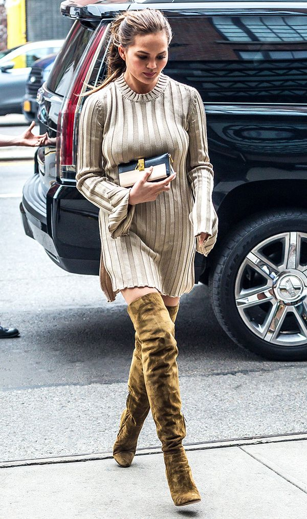 On Chrissy Teigen: Jimmy Choo Toni Boots ($1983); Chloé Drew Bicolor Zip-Around Wallet ($446) Stay warm in style by pairing over-the-knee boots with a cozy-chic sweaterdress.