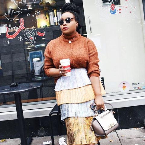 cold-weather outfits: a chunky knit and a metallic skirt