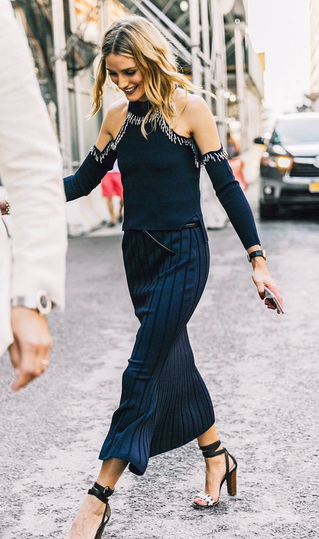 Olivia Palermo at NYFW in embellished cutout shoulder top, midi skirt, and heeled sandals.