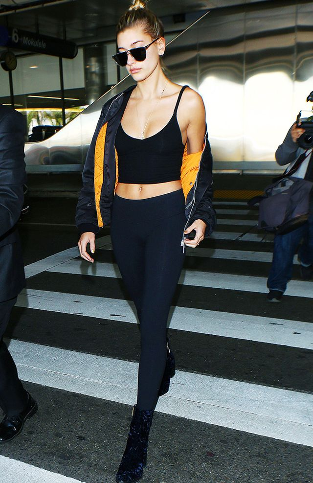 On Hailey Baldwin:Are You Am I Dewi Tank(£63). Shop Similar: James Perse Fleece Leggings(£165); Gianvito Rossi Rolling Velvet Ankle Boots(£615); Topshop...