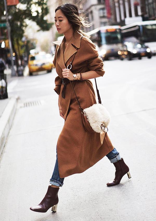 On Aimee Song: Zara coat; Paige Sequin Star Patch High Rise Straight Leg Jeans (Jupiter Embellished)($339); Diane von FurstenbergShearling Love Power Saddle Bag ($238); Céline boots.