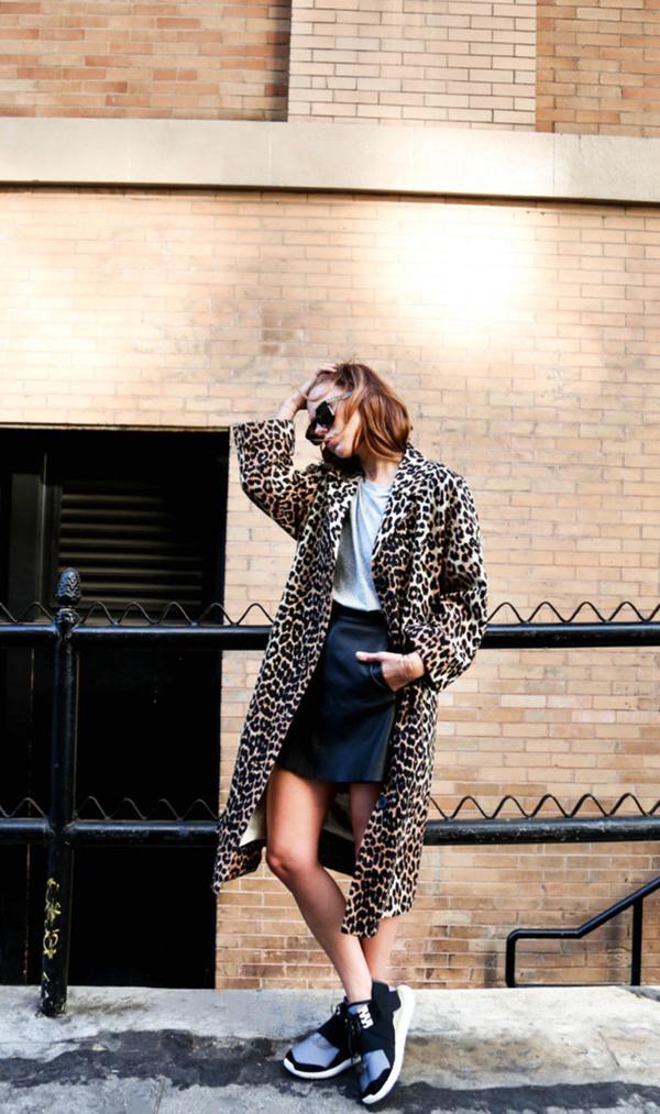 On Courtney Trop: Ganni coat; Acne Studios Grey Dorla T-Shirt($76); Veda skirt; Adidas Qasa Elle Trainer Sneaker in Night Metallic($385).