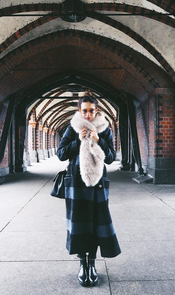 On Saray Martín: ASOS Coat in Oversized Check($128); ASOS faux-fur scarf; Parfois boots.