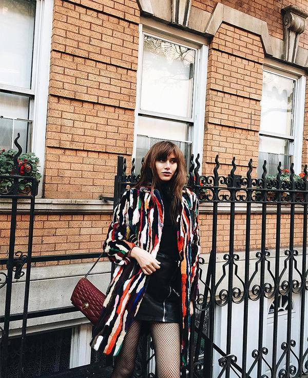 On Natalie Suarez: Jocelyn The Roxbury – Multi; Gap Maximum Heat Long Sleeve Turtleneck Tee($30); The Kooples Leather Zip Front Mini Skirt; Bally bag.