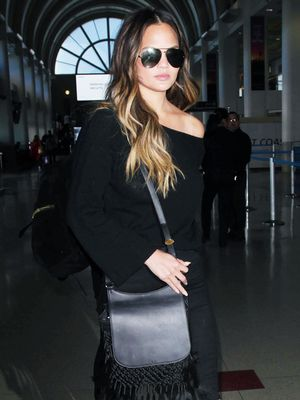 Chrissy Teigen Rarely Goes Anywhere Without These Sunglasses