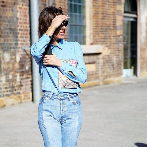 How to wear high-waisted jeans: With a tucked-in shirt and mules