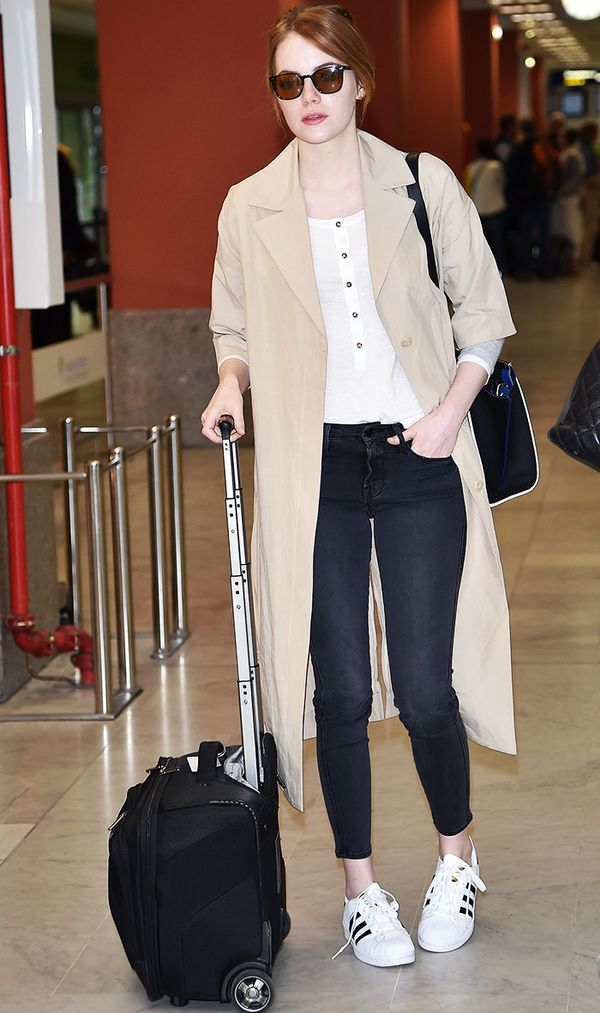 Emma Stone airport wearing adidas sneakers