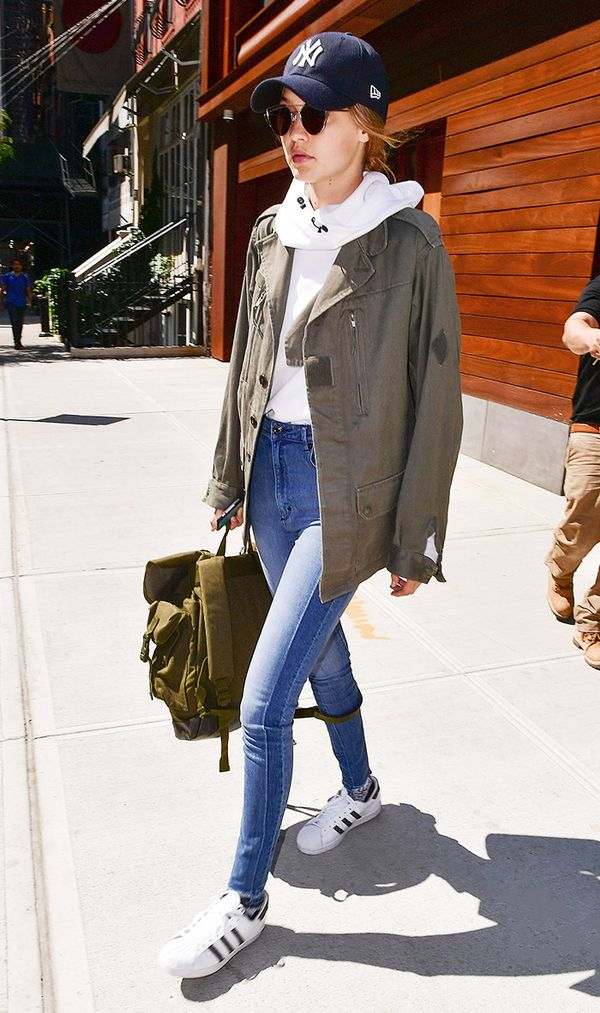 Style Notes: Gigi Hadid stuck to a sporty-chic uniform, adding skinny jeans, a sweatshirt, and an army jacket.