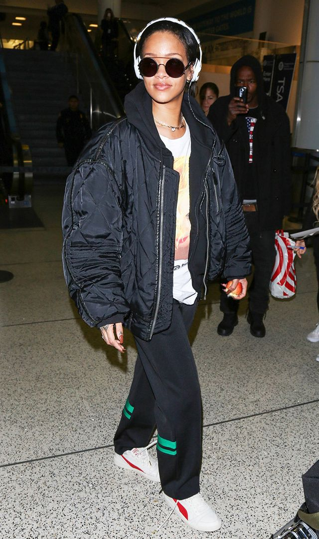 Rihanna at Los Angeles International Airport in quilt hooded bomber jacket, t-shirt, and sweatpants