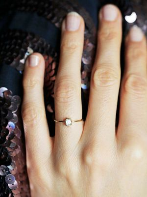How to Make a Tiny Engagement Ring Look Much Bigger