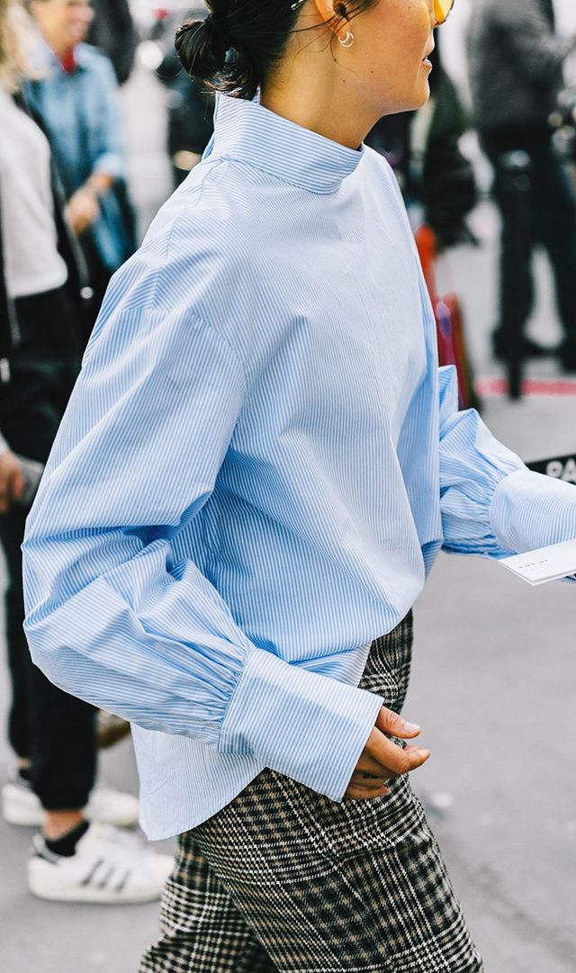 Paris Fashion week street style striped blouse on plaid pants