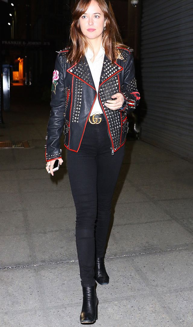 Dakota Johnson in New York City wearing studded, floral leather jacket and belt from Gucci