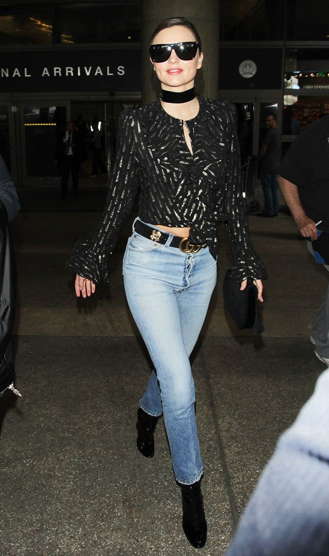 Miranda Kerr at LAX in Gucci belt, jeans, and Saint Laurent sunglasses