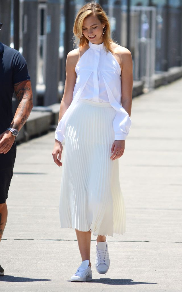 On Karlie Kloss: Dion Lee Cut-out Cotton Shirt($392), Adidas Superstar Foundation Sneakers($130).