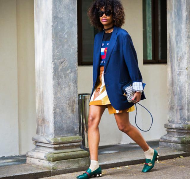 Jan Quammie street style in blue blazer, yellow print mini skirt, and gucci heels