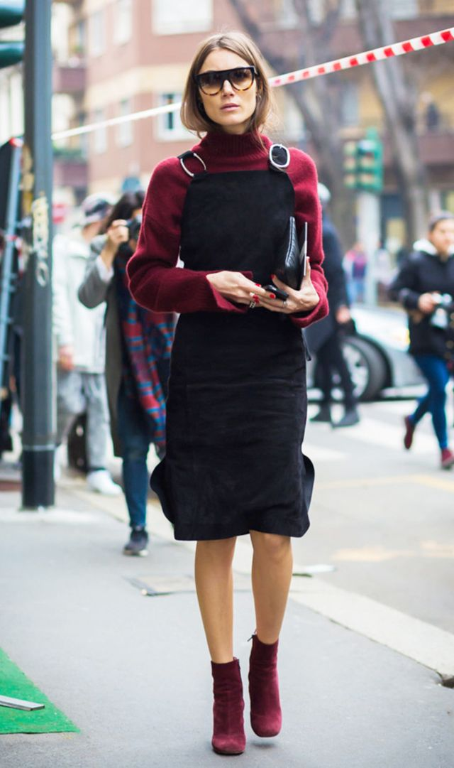 Giorgia-Tordini street style in red sweater, black dress, and red ankle boots