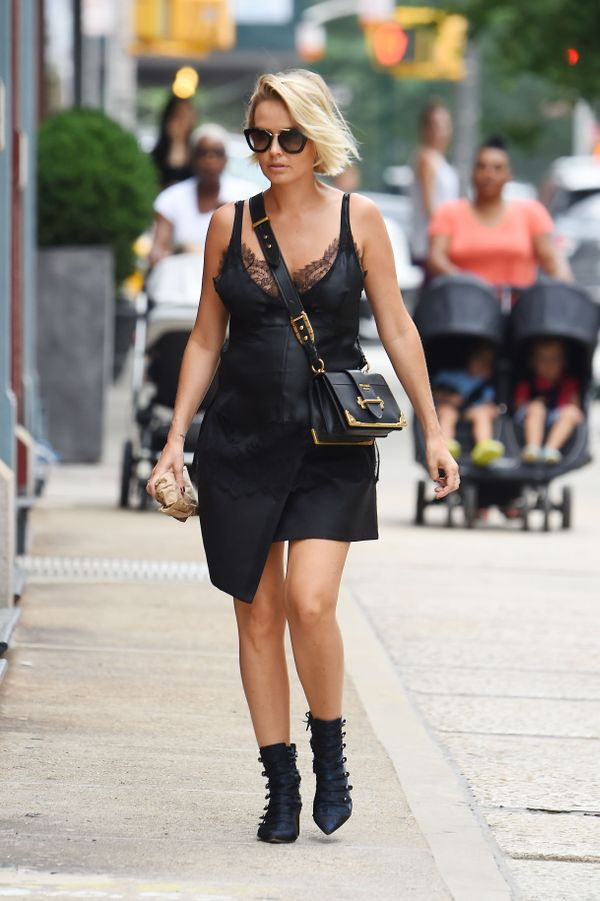 This look is all about the Prada bag, and Diorboots.