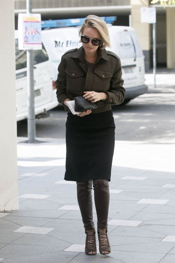 This is Lara's version of winter style. We love how she's worn over-the-knee boots layered under a pencil skirt.
