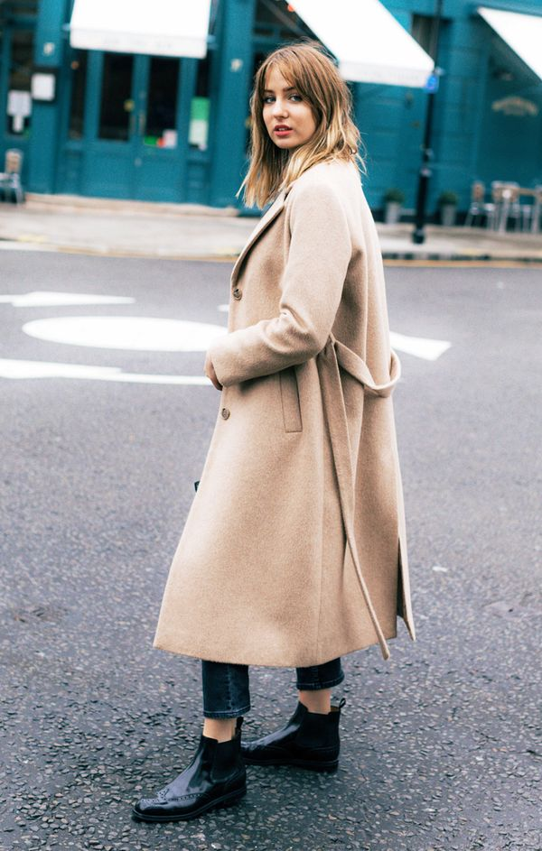 Style Notes: Lizzy Hadfield proves that sometimes you just can't beat a classic, as her Chelsea boots and camel coat look effortless but expensive.