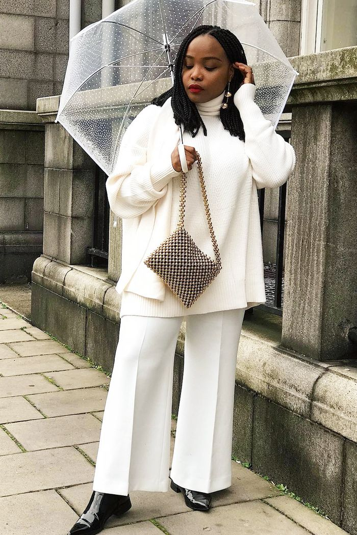 Winter outfit ideas: Aga Oguntodu wears Zara white jumper and Wallace trousers